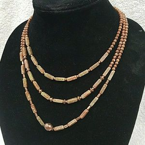 Jewelry - A 3 strand tiered beaded necklace.